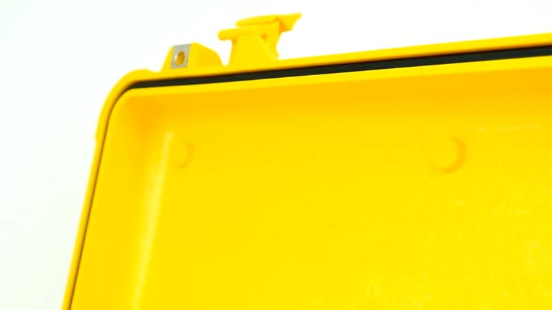 Close up of the lid bosses in a yellow Peli case
