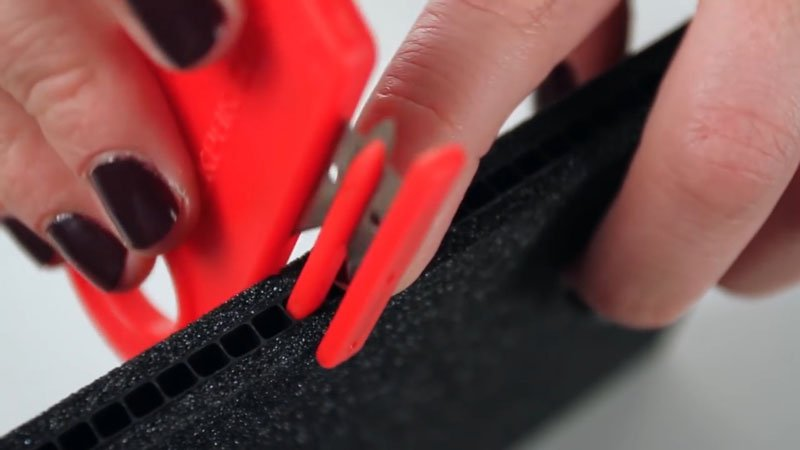 Close up of a TrekPak divider being cut with the included cutting tool
